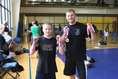 Arlo (the tall one) and Justin with the first grappling medals of their career.